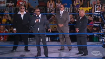 LtR: Samoa Joe, Magnus, Sting, Kurt Angle. Samoa Joe is heavy set/husky and hence even though it's not really translated through a screen capure like this the retro collar and cuffs did not help him. Magnus wore a beautiful suit. On the show it looked simply elegant and well crafted, it fit him perfectly, the best suit of the bunch. Fitted from top to toe with a good waist and contemporary style, even showing a touch of his shirt underneath in a fashionable way. Sting wore a basic suit which bothered me, the man has funds and is on tv and on top of that was a playing a part in a group called the 'main event mafia' using stereotypical mafia music and supposedly dress. His suit was well cut for his body but lacking in finesse and the colour did nothing for his particularly with the sunglasses. (On top of that it didn't suit his 'cool' and striking character, he went from bold to bland in costume.) Kurt angle also wore a well cut suit for his figure and the crew neck complimented his thick/wide neck, it looked sleeker than Sting's mediocre fayre but not by much.