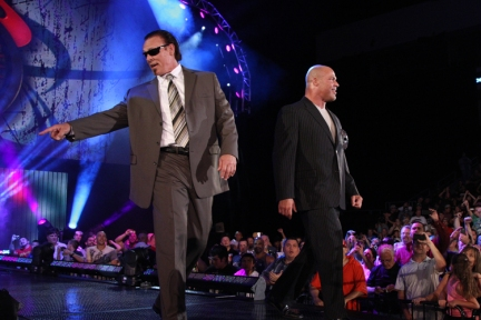 Sting's and Kurt Angle's suits in better detail. Can see they are in good proportion to their bodies, not too wide which would make them look squat and the right lengths on the sleeves.