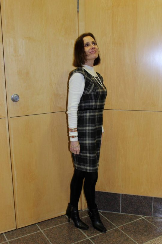 Nicole's wearing her favourite sheath dress, a classic shape, colour scheme and print that as she says ' can go from sophisticated to girlie to street style.'
