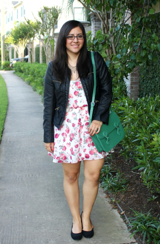 Adorable in her lovely flowery dress made smart but quirky with the satchel and shoes yet edgy with the jacket. I'm likin' her sense of style and pops of colour!
