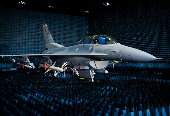 U.S. Air Force photo by Samuel King Jr./Released - https://www.flickr.com/photos/usairforce/15710179866/ A 40th Flight Test Squadron F-16 Fighting Falcon sits in the anechoic chamber after completion of the initial round of testing simulations on the new M-7 software upgrade Oct. 30, 2014, at Eglin Air Force Base, Fla. The M-7 software package will provide multiple advanced capabilities to the aircraft. The anechoic chamber is a room designed to stop reflections of either sound or electromagnetic waves. The room is insulated from exterior sources of noise. The room is part of a facility that allows testing of air-to-air and air-to-surface munitions and electronics systems on full-scale aircraft and land vehicles prior to open-air testing. (U.S. Air Force photo/Samuel King Jr.)